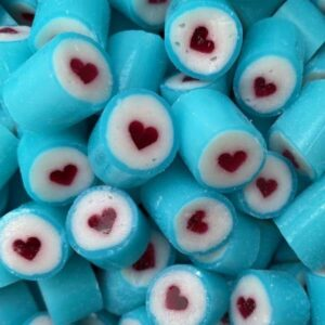 Rock candy with a blue outter wrap and a centered red love heart. Lemonade flavour.