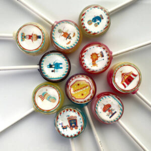 Circus themed lollipops including tents, merry go-rounds, lion tamers, canons, seal balancing a ball on its nose, horse and carriage.