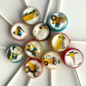 Construction Pops including dump trucks, fork lifts, cranes, diggers, cement mixers, jack hammers and tractors edible designs inside a lollipop..