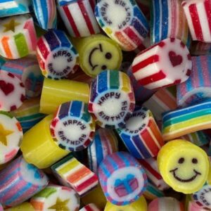 Happy Birthday mix themed rock candies including Happy Birthday text, smiley faces, hearts, stars and presents.