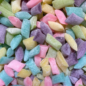 Sour Suckers are sour candy pebbles in assorted fruit flavours including Lemon, Pineapple, Passionfruit, Cherry & Lemonade.