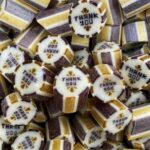 Gold and silver striped 'Thank You' candy with a grape flavour. Suitable for weddings. Vegan friendly.