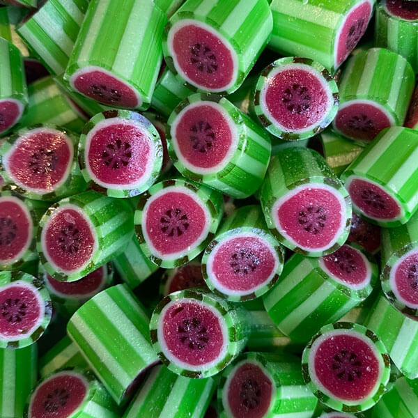 Watermelon flavoured rock candy lollies. Available in 80g jars, 80g bags, 230g jars and 1kg bulk bags.